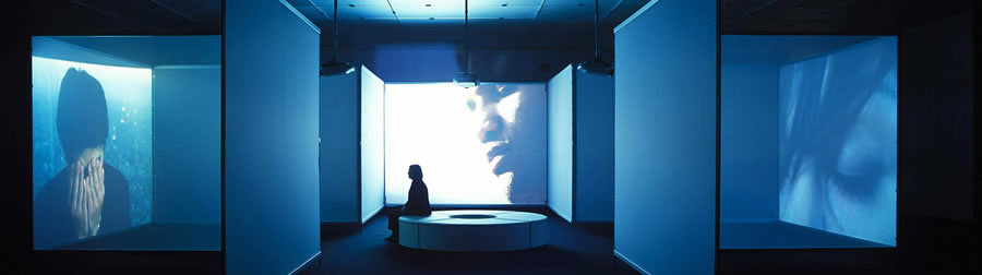 interiors, [barrenak / interiors / interiores], 2002<br />3 channels digital video and soundinstallation with 3 projections in architectural environment, 6:55 minute cycle<br />Col�lecci� de la Fundaci� �la Caixa�<br />� Doug Aitken